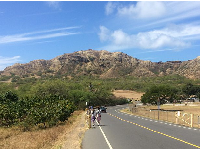 The road that leads into the park, with Diamond Head crater up ahead.
