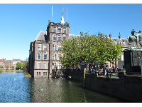 Binnenhof, as seen from the bridge across Hofvijver Lake. Statue of William II on horseback.