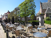 Brasserie seating in front of the old church.