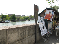 Painters sell their work above the Seine River, at Pont Neuf.