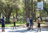 Guys having fun playing basketball.