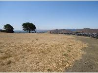 The dry, flat grassy area at the top.
