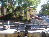 Beautiful views of a European inn, from the outdoor seating at Splash Cafe.