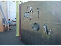 Magnetic wall with metallic utensils.