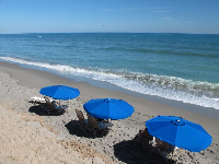 Blue umbrellas at Jupiter Beach Resort.