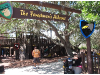 Forestmen's Hideout, a wooden playground under trees.
