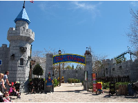 The Dragon rollercoaster, set in a castle with beautiful imagination elements.