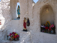 The statues in the grotto.