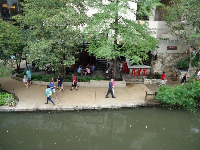 People strolling along River Walk.