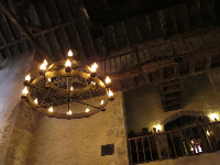 The chandelier and wooden balconies inside Leaky Cauldron cafe.
