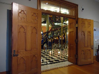 Carved wooden doors, and checkered floor.