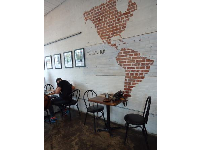 The Americas, in brick, at Reve Coffee Roasters.