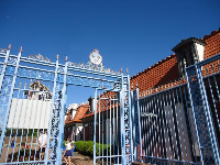 Pale blue ironwork entrance gate.