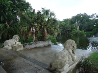 Lion statues at the water.