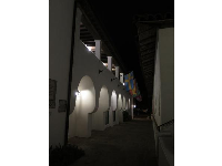 The chunky archways at night.