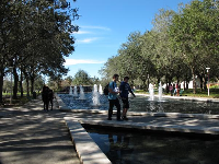Student walk past the fountains.
