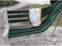 Melting clock on a wonky bench!