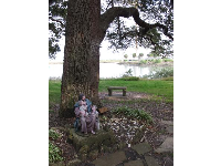 Sweet statue of Jesus and the children, under a gorgeous tree by the water.