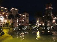 The Lightner Museum and Casa Monica lights reflecting in the fountain pool at Christmastime.