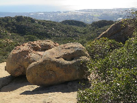 View of the ocean and two boulders.