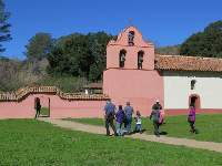 A family visits the mission.