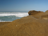 The rock is a striking color at Pescadero State Beach.