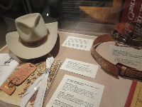 Reagan's cowboy hat, spurs, and leather straps.