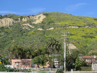 The town of La Conchita, sits hazardously below a steep mountain with rock slides- across the highway from Mussel Shoals.