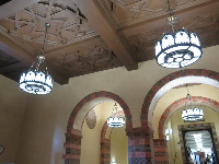 The gorgeous ceiling, arches, and lanterns in Powell Library's lobby.