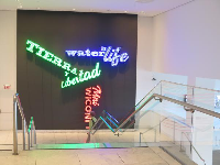 Neon exhibit, between first and second level of museum.