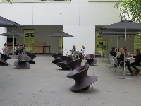 The swaying chairs, and some tables and umbrellas.