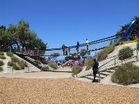 The swaying bridge, and sandy playgrounds below!