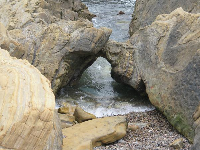 Little arch on the coastline at Point Lobos State Reserve.
