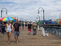 A couple strolls along the pier.