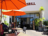Orange umbrellas and cute plant outside Kahuna Grill.