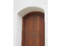 Side doorway with decoration.
