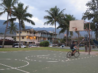 Bike riding on the basketball court.