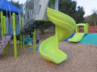 Twisty slide on the toddler playground.