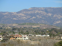 View of mountains, lemon groves on the foothills, and new housing developments on the Venoco land.