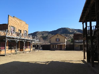 Wild west town and mountains beyond.