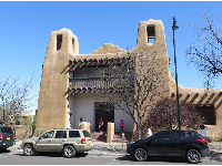 Cute adobe buildings with bell towers.