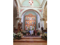 The altar screen with fifteen saints and St. Francis at the center.