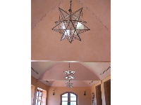 Maravilla Restaurant's pink ceiling and Spanish star chandeliers.