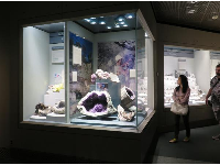 A woman walks past the amethyst exhibit.