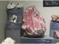 Rhodonite with Calcite and Franklinite, from New Jersey.