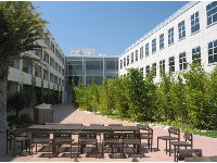 Cafe with outdoor seating, and views of modern Elings Hall.