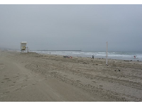 Early morning at Mission Beach is a quiet scene. See the nice sand. Evenings find the beach packed with fun-seekers.
