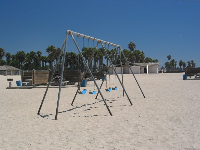Swings and picnic spots on the beach.