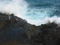 A blast of water spurts out at Halona Blowhole.