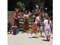 Kids dance to Caribbean music at the Music Bowl.